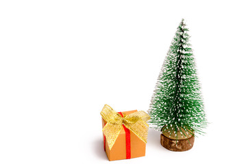 Christmas tree ready to decorating with present on an isolated white background. New Year's holidays. Christmas shopping and preparing for the holiday. Place for text. Copy space