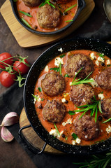 Meatballs with sauce on skillet