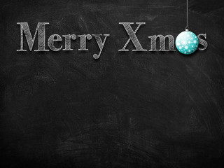 3d illustration rendering of chalk Merry Christmas wishes on blackboard with blue Christmas tree decoration ball