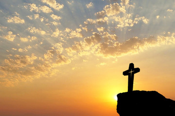 Silhouette of Jesus christ crucifix on cross over sunset.Concept for Catholic religion, Christian worship, Christmas, Easter Day, Bible,Thanksgiving prayer and praise good Friday.