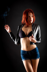 sexy girl with a cigarette on a dark background