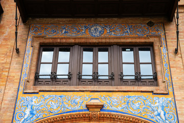 windows at a historical building in Seville, Spain