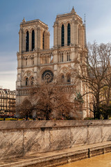 Beautiful winter view of the Notre Dame Cathedral and the River Seine in Paris, France