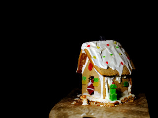 Beautiful gingerbread house on a dark background