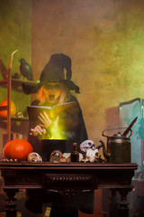 Image of witch on cauldron with steam