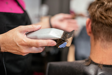 Man having his hair cut in a barbershop