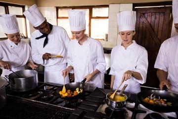 Chef preparing food in kitchen