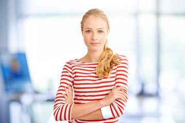 Young beauty female portrait. Attractive young blond woman wearing striped shirt while looking at camera and smiling.