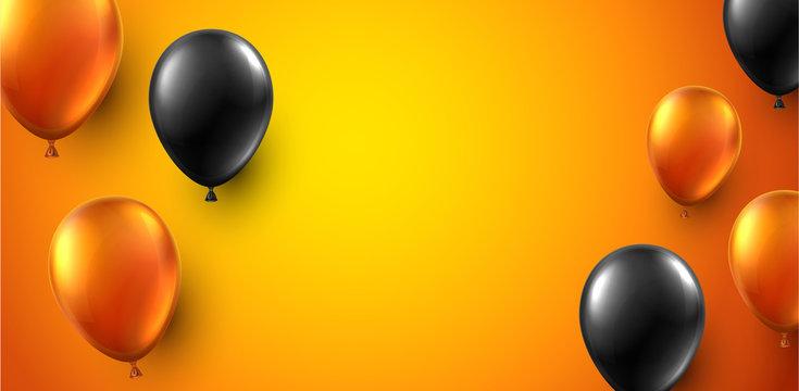 Festive background with black and orange shiny balloons.