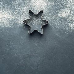 Baking accessories on black background with flour. Christmas winter dark background