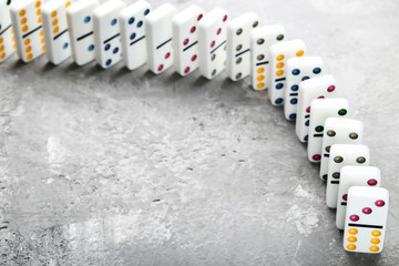 Dominoes on grey wooden table