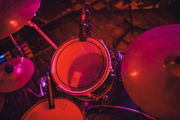 Drum kit on stage in the spotlight color.
