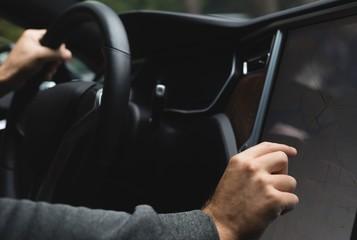 Man using navigator map while driving a car