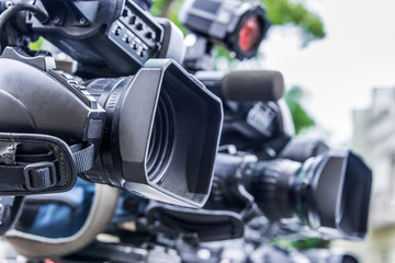 Professional tv cameras on tripods recording social event