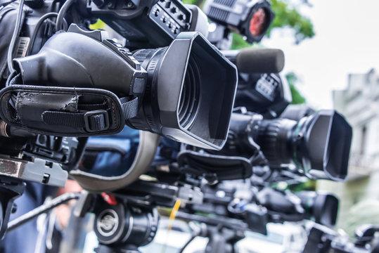 Professional tv cameras on tripods recording social event