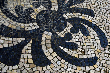 Stone mosaic on the street of Lisbon