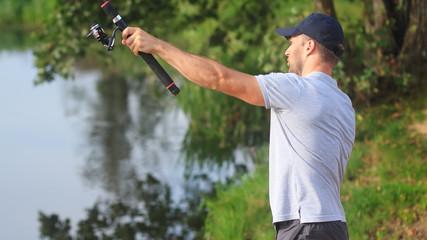 Fisherman throws fishing line in river