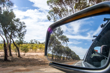 Rear mirror landscape of outback