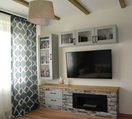 Biofireplace in a living room interior. Scandinavian style