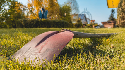 Shovel lying in the grass - low stance perspective