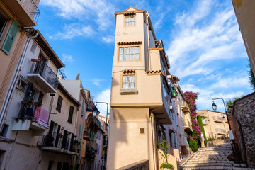 Wide angle view to a narrow street in Cannes