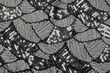Black fabric with shiny silver sequin design