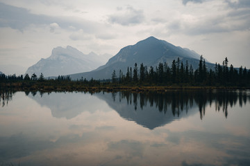 Reflecting Canadian mountains on Vermillion lakes Banff