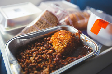 Fotobehang Assortiment View of food for the passengers in the air plane, lunch for airline passengers, russian dinner meal menu at airplane