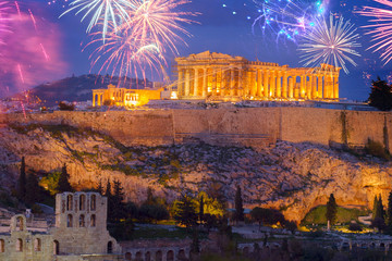 Famous skyline of Athens with Acropolis hill and Pathenon illuminated at night with fireworks, Athens Greecer