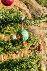 Decorated Christmas tree in the forest