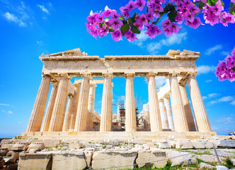 Wall Mural - facade of Parthenon temple over bright blue sky background with flowers, Acropolis hill, Athens Greece