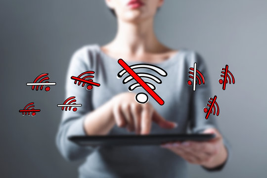 No WiFi theme with business woman using a tablet computer