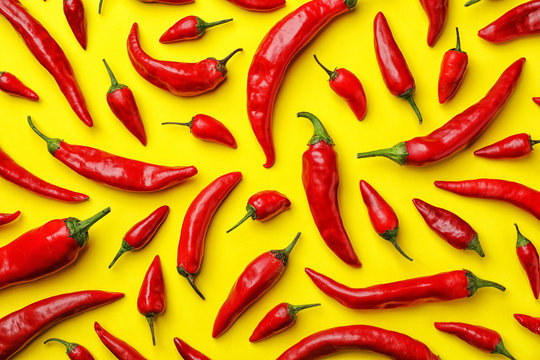 Flat lay composition with fresh chili peppers on color background