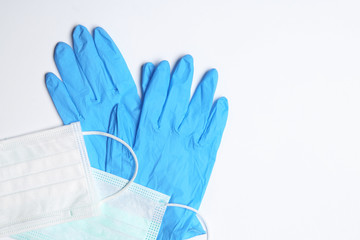 Flat lay composition with medical gloves on white background