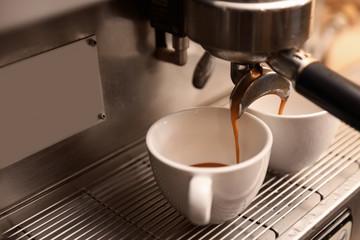 Preparing fresh aromatic coffee using modern machine, closeup. Space for text