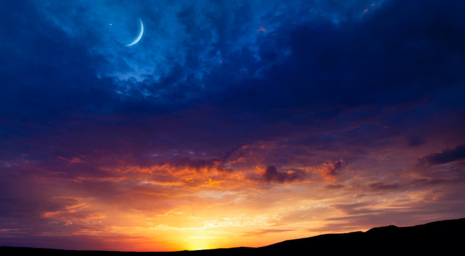 Crescent moon with beautiful sunset background . Generous Ramadan  .  Light from sky . Religion background .Crescent moon with beautiful sunset background .  Light from sky . beautiful sky