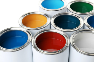 Open paint cans on white background, closeup