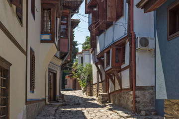 Street and houses from the period of Bulgarian revival in old town of city of Plovdiv, Bulgaria