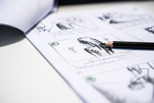 Pencil on Storyboard movie layout for pre-production, storytelling drawing creative for process production media films. Script video editors and writing graphic in form displayed in maker shooting