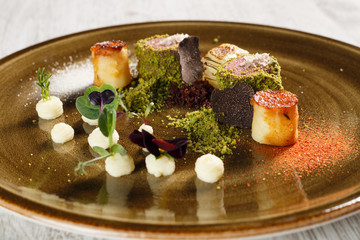 Fine cuisine cooked veal, covered in ground pistachio with truffles
