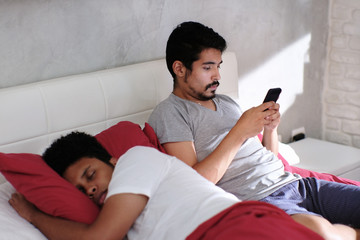 Man Cheating His Partner Texting On Smartphone