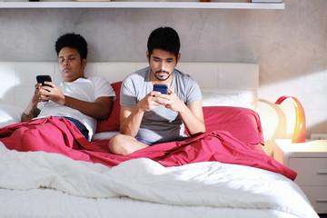 Homosexual Men With Smartphones Ignoring Each Other