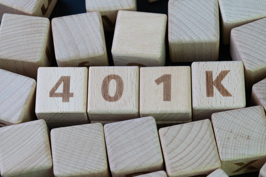Retirement plan 401k, investment for senior concept, cube wooden block with alphabet combine the word abbreviation 401k on black chalkboard background
