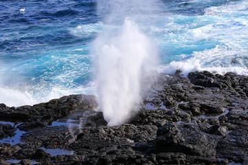 Water bursts through blowhole on Espanola Island, Galapagos National park, Ecuador.