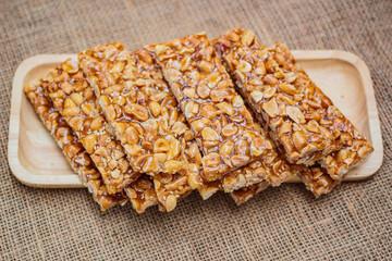 Obraz Peanut sesame snack, (Tua gra joak) sweet peanuts stick. - fototapety do salonu