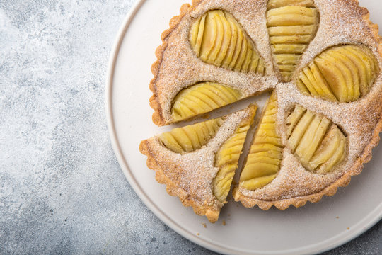poached pear and almond frangipane tart, top view