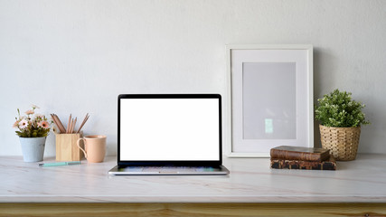 Bloggers workspace blank screen laptop ,poster frame mockup with copy space