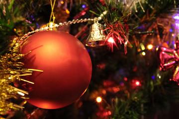 Red big Christmas ball hanging on the Christmas tree.