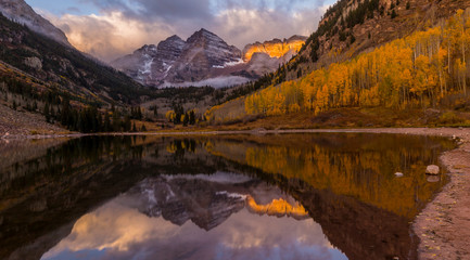 sunrise in the mountains - maroon bells and lake, aspen colorado CO USA
