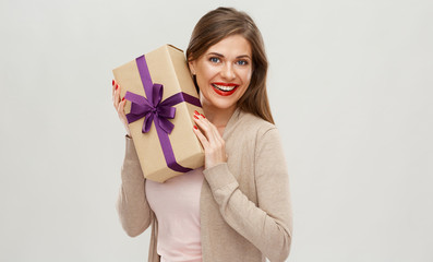Happy girl holding gift. Isolated portrait